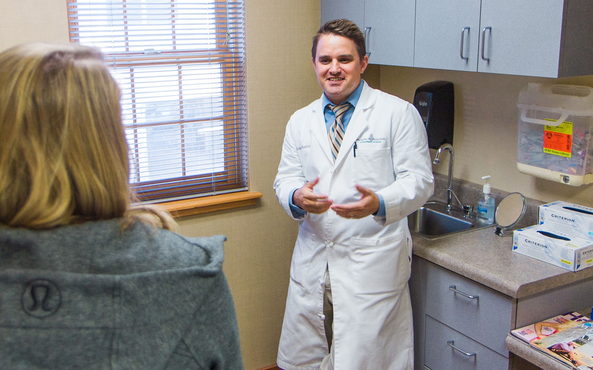 Doctor and patient during exam at Plastic Surgeons of Northern Arizona